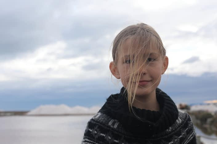 Beautiful Silke with mountains of salt behind her